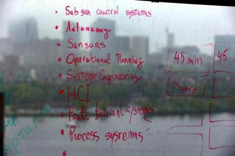 Technicians' notes were written on an office window that overlooks the Charles River and the Boston skyline.